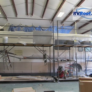 Coach-surrounded-by-scaffolds-at-the-RVRoof-com-shop